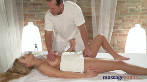 Masseur cums on butt of busty girl after coition