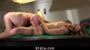 Tatted up beauty fucked by an old man on a pool table