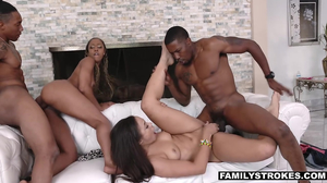 Big black cocks fuck a pair of horny ebony babes