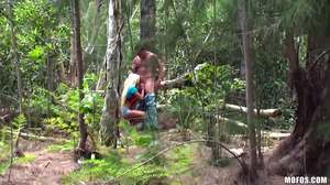 Kinky couple is caught fucking in the woods
