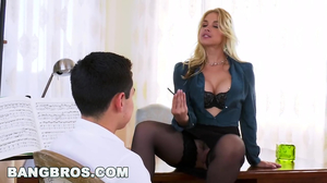 Sexy blonde music teacher seduces a young boy